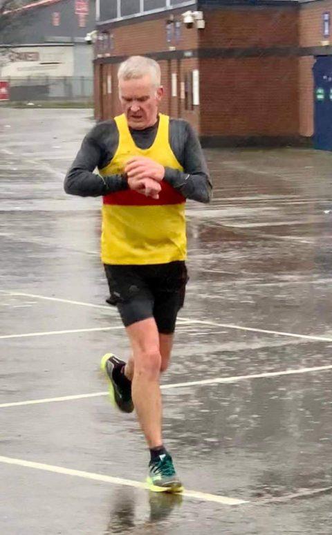 Steve running in the rain
